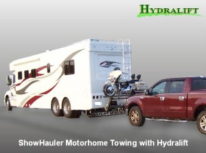 Towing Showhauler Motorhome towing with Hydralift